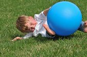 Toddler Playing With Blue Ball