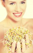 Beautiful caucasian woman with green fresh cress.