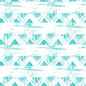 foto of primitive  - Vector seamless ethnic zigzag pattern with bold brushstrokes and stripes in bright aqua blue color can be used for print - JPG