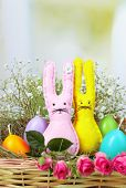 stock photo of ear candle  - Funny handmade Easter rabbits in wicker basket - JPG