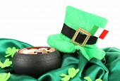 Saint Patrick day hat, pot of gold coins and Irish flag, isolated on white