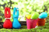 pic of ear candle  - Funny handmade Easter rabbits on green grass - JPG