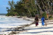 Two Zanzibar Women On Sandy Beach