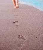 pic of footprints sand  - a Women - JPG