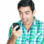 Close-up of an angry man yelling at his mobile phone (isolated on white)