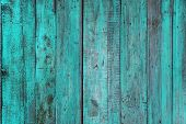 blue painted old wooden wall. cyan background