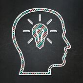 Information concept: Head With Lightbulb on chalkboard background