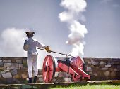 stock photo of ticonderoga  - A canon is fired during ceremonies at Fort Ticonderoga - JPG