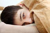 Tired Teenager Under Blanket