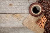 Coffee cup and spices on wooden table texture with copy space. View from above