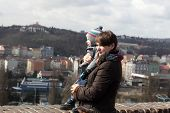 Mother With Son Looking At Prague
