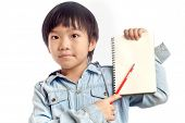 Boy Holding Notebook With Pencil