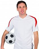 Smiling football fan in white on white background