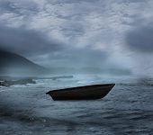 Sail boat on open water in a storm