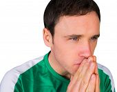 Nervous football fan in green on white background