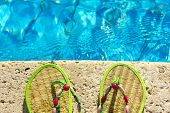 picture of platform shoes  - Two flip flops on the platform beside swimming pool - JPG