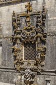 Tomar, Portugal - July 18, 2013: Famous Chapter House Manueline style window, in the Templar Convent