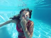 Young Female Holding Her Breath Underwater