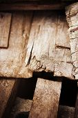 Old and deteriorating wood panels of old house. abstract macro