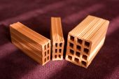 stock photo of obra  - pile of small scale model of red bricks