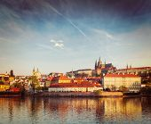 Vintage retro hipster style travel image of Gradchany (Prague Castle) and St. Vitus Cathedral over V