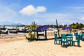 pic of beachfront  - Landscaped beachfront restaurant with umbrellas and chairs - JPG