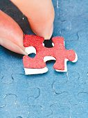 Assembling The Last Red Piece Of Puzzle