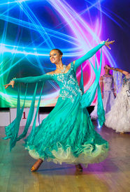 image of waltzing  - Female dancer performs at dance championship - JPG