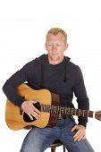 Man In Hoodie With Guitar Look Down