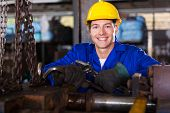 portrait of industrial manual worker in workshop
