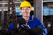 happy blue collar worker with tools in workshop