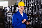 portrait of handsome gumboots factory quality controller