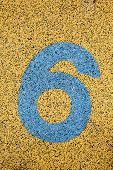 Number Six Sign On Sand Fome