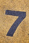 Number Seven Sign On Sand Fome