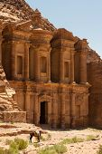 stock photo of camel-cart  - Facade of the Monastery one of the famous monuments of the ancient Nabatean city of Petra Jordan - JPG