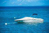 picture of recreational vehicles  - Small Motorboat on the Clear Blue Lake Water - JPG