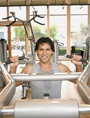 picture of pacific islander ethnicity  - Pacific Islander man exercising in health club - JPG