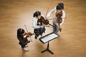 picture of pre-adolescents  - Asian girls playing violins - JPG