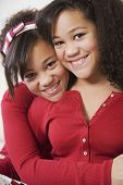 image of pre-adolescents  - African twin sisters hugging - JPG