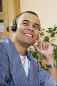 Pacific Islander man wearing headset