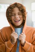 Mixed Race boy wearing hooded sweatshirt
