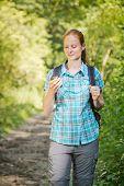 Hiker Navigating With Digital Maps