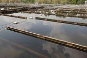 stock photo of wastewater  - Wastewater treatment plant aerating basin - JPG