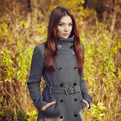 picture of coat  - Portrait of young beautiful woman in autumn coat - JPG