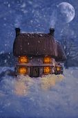 Cosy country antique ceramic cottage with falling snow