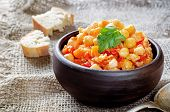 stock photo of pangasius  - chickpeas with vegetables and pangasius on a dark background - JPG