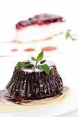 Chocolate fondant with peppermint leaves