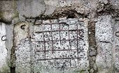 picture of mortar-joint  - Grey concrete surface with visible blocks joints and reinforcement bars - JPG