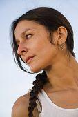 Hispanic woman with braid