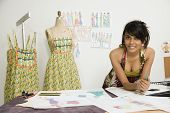 Indian female fashion designer in workshop